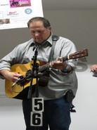 Guitar player from Mackville performing at the bluegrass festival